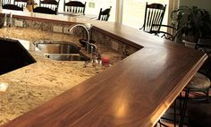 Walnut Wood Countertop, Raised Breakfast Bar. Shenandoah Millwork. Design by Mary Hines. https://www.glumber.com/ (Bar Top Design)