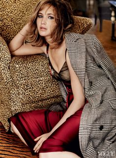 Lawrence feels more herself on a movie set than anywhere else. Ralph Lauren Collection wool-houndstooth coat and maroon satin dress with beaded detail.