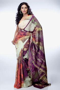 A saree with ornaments in graphic style comes with a brown crepe-de-chine blouse piece.