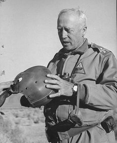 Gen George S Patton Jr inspecting a helmet while on training maneuvers in the desert George Patton, War Photography, United States Army, Military History, Us Army, World War Ii, American History, Wwii, Military Figures