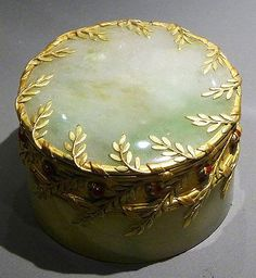 Antique candy box 'Ladybugs' (they are circling the side of the lid) by the Falize brothers.  Jade, gold and enamel c1900. Photo by canecrabe