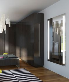 The Fusion™™ Lighted Wardrobe Mirror is full length, has two bands of vertical frosted light, comes in two standard sizes, and has many custom upgrade options.