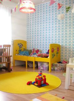 Children's room with yellow and patterned wallpaper