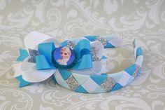 Frozen's Elsa headband with matching Elsa bow and bottle cap. Bow is not yet attached, will be put on headband, French barrette or alligator clip at buyers request.   4 ribbon weave. Headband fits toddler to adult in most cases.   $8.00 USD directly placed on headband, $8.50 on barrette or clip.  I will be adding more of these ASAP! Frozen Headband, Hair Boutique, Handmade Headbands, Girls Hair Accessories, Elsa Frozen, Sell Items, Barrette, Sweet Girls, Girl Hairstyles
