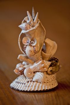 A whimsical thank you gift to tell your bridesmaid or other wedding helper how special they are to you. Handcrafted of Sanibel Island shell fragments, with a tiny owl tucked safely in his hole. Click here to see closeup photos. http://www.lowtidetreasure.com/suess-ish-owl-ish/  $34.99