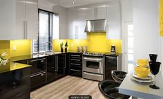 Tri Tone kitchen, space illumination and height creation through clever colour schemes.   Black anchors the kitchen, the white cupboards give the illusion of space and height, the yellow spashbacks add warmth and and cause your eye to ignore the top cupboards increasing the illusion of height and airy space.