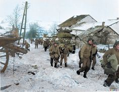 American troops advance in the snow during the Battle of the Bulge.