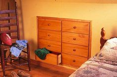 It's an awkward corner of the house. Why not make it a space-saving dresser?