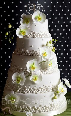 Maybe fun to add the look of pearls from your ring to the wedding somewhere.  White Orchids & Pearls Wedding Cake