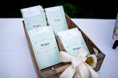 The Recipe Books given to guests as favors were designed by Maid of Honor and her boyfriend, and are full of recipes collected from friends and family before the wedding, and printed in bulk from Blurb.