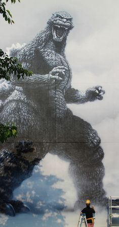 A mural of the beloved kaiju Godzilla being applied outside the Toho studios, Tokyo, Japan, 2014, photograph by bellybutton.