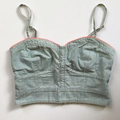 American Eagle chambray crop top Light chambray blue crop top with pinkish-orange embroidery at the seam. Shirred back for a tight fit, best fits a 34 A-C cup. Adjustable straps. American Eagle Outfitters Tops Crop Tops