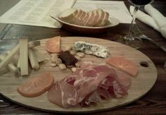 Cheeseboard (Jamon Serrano, Persimmon, Roquefort, Aged Smoked Gouda, Quince Paste & Marcona Almonds) & Malbec from the now Closed Anthony's Fine Food & Wines on Foothill Blvd. & Hobbs Dr. in La Cañada Flintridge, California.