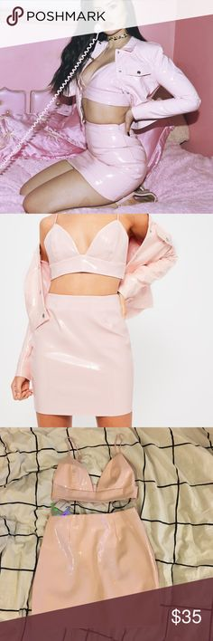 missguided x galore pink patent faux leather set Make all your barbie dreams come true with this mouth-watering kawaii yet sexy combo! The bra is US size 4 and the skirt is US size 6. Both best for a size small. NWT. I had to take off the tag from the bralette to try it on but it didn't fit me. There is are two small scuffs on the front and back of the skirt as pictured in the last photo. I'm sure they wipe off but I didn't know what to use. Missguided Dresses Mini