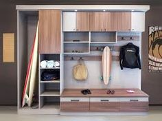 As anyone who lives near a beach can attest, transitional zones are a necessity for trapping the residuals of fun in the sun. A sand-room unit includes a spot for the surfboard and plenty of beach towels. Photo courtesy of California Closets California Closets, Mudroom Cubbies, Mudroom Benches, Trends, Home Organization, Organizing, Hgtv, Home Remodeling, New Homes