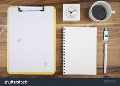 Office Desk Table With White Blank Paper And Notebook , Clock, Pen, Cup Of Coffee And Usb Drive. Top View With Template Copy Space…
