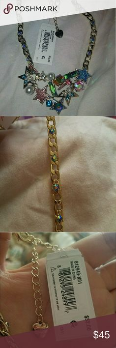 Betsey Johnson Pearl star Statement necklace This sparkling bib necklace features a colorful mix of jeweled stars and sleek pearls. Its gold-tone cuban link style chain features bright stone accents for a luxe touch. Betsey Johnson Jewelry Necklaces