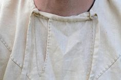 neck closure of the 11th C Torllkona Viborg Denmark shirt. Square neck opening Shirt with flap opening & ties
