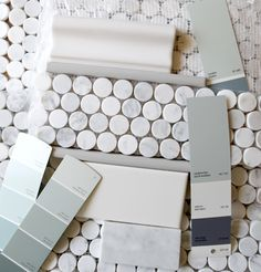 Carrara penny-round tile trimmed with chair rail, liner, white subway tile walls, gray & soft robins egg blue paint