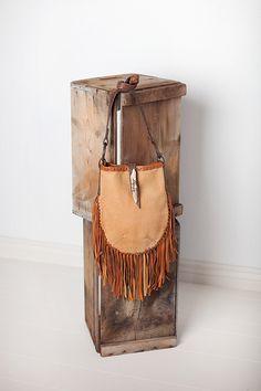 Buffalo leather fringe bag with vintage horse tack strap