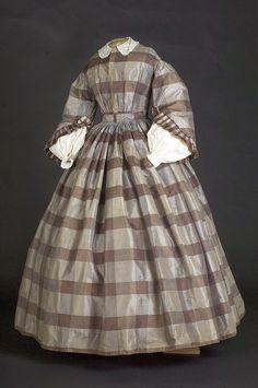 Brown plaid silk day dress   Date: ca. 1850-1855   Notes:  Likely this dress has been altered. It came with some extra scraps saved b...