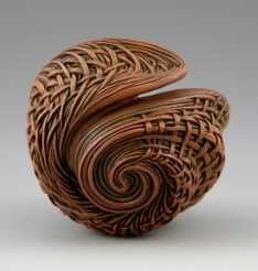"""""""Sea of Entwined Dreams"""" 2008   3.5x 2.5 D, carved/ textured cherry, acrylics. collection of Dr. Jeffrey Bernstein and Dr. Judith Chernoff"""