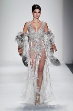 Organza ruffles and silver fox stole from the Fall 2011 Farah Angsana Collection