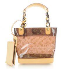 This is an authentic LOUIS VUITTON Cabas Sac Ambre MM Vinyl Cruise w Pouch.   This stunning tote is crafted of Louis Vuitton monogram embossed vinyl in amber.