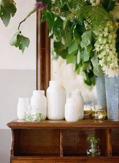 Paint the inside of mason jars white and drop in a candle for soft ambience. Via Gardenista