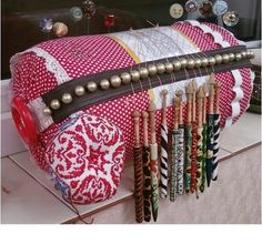 "Asociación Encajeras de Bolillos ""Ibn al Baytar""bobbin lace pillow with beads to separate the bobbins!"