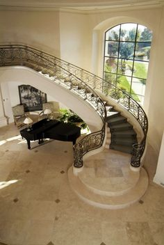 window in stairs and piano under stairs...ahhh piano, perfect one to replace the piano that got destroyed :)