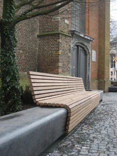 Timber seat wrap over concrete bench.