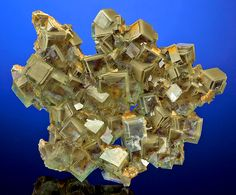 Rare specimen featuring zoned cubes of Green Fluorite with sand inclusions. From the Xianghuapu Mine, Linwu Co., Chenzhou Prefecture, Hunan Province, China. Measures 8.2 cm by 10 cm by 2 cm in total size. Ex. J. Webb Mineral Collection-