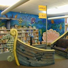 The children's room has a cool boat.