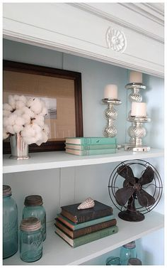 - love the old fan and glass jars for your bookshelves in the front... With green/blue accents