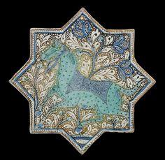 کاشی ستاره کاشان، اواخر قرن 13 اوائل قرن 14 میلادی، 20.6 سانتیمتر A KASHAN COBALT-BLUE, TURQUOISE AND LUSTRE PAINTED POTTERY STAR TILE  IRAN, LATE 13TH/EARLY 14TH CENTURY  Showing a finely drawn horse over a lustre ground with dense foliage, the horse's dotted coat highlighted in turquoise blue, the saddle blanket and the bridle highlighted in cobalt blue, a blossoming tree growing from a small pond in the ground. 20.6cm
