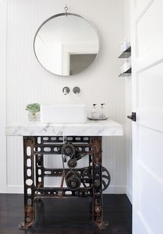 Steampunk bathroom sink--LOVE IT!!  How about an old treadle sewing machine base?