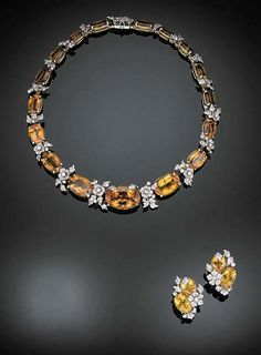 A SUITE OF CITRINE AND DIAMOND JEWELRY, BY VERDURA Designed as a graduated line of oval-cut citrines alternating with pavé-set diamond foliate terminals; and a pair of ear clips en suite, mounted in 14K yellow gold and platinum, necklace, 15 ins. Signed Verdura: