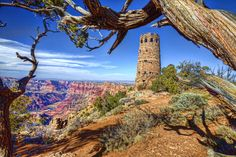All Along The Watch Tower: HDR photography- A great vista point at the Grand Canyon exemplifies the shear magnitude of the canyon from atop the watch tower. The Colorado River in the distance still ever busy digging deeper into the canyon floor. See more at: www.travelbugster.com