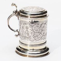 A Russian silver-gilt tankard decorated with engraved floral motives and three scenes of angel, dragon and flaming hart. Hallmarked Moscow, Imperial warrant and 84 standard (875/1000 silver), maker mark Cyrillic C.P. (Peter Semenov). SIZE: H 6 in. (15.2 cm), weight 16.07 oz t (500 g).