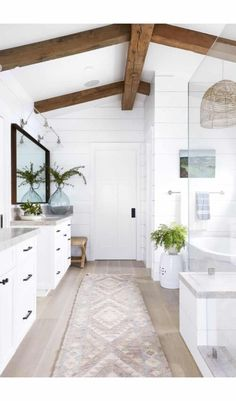 Bathroom Renos, Bathroom Renovations, Home Remodeling, Shiplap Master Bathroom, Skylight In Bathroom, Chandelier In Bathroom, Bathroom With Wood Floor, Best Bathroom Flooring, White Bathroom Cabinets