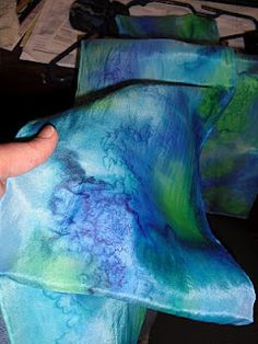 Silk Scarf Painting Tutorial.  Oh yeah!  She uses dyes so they need to be steam set - don't want to mess with that... but think this method probably works with paints, too.  Also has posts about steaming and ironing to set.