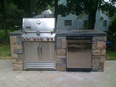 A Very Simple Outdoor Kitchen With A Bbq Grill Sink And Refrigerator