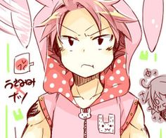 Natsu in that bunny costume made my day and his face is pure irritation . (I bet Lucy forced him to wear it)