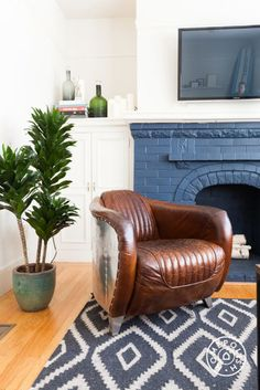 "Zach's Modern, Chill and Comfortable SF Home - This (incredible) armchair is vintage but <a href=""https://www.restorationhardware.com/catalog/product/product.jsp?productId=prod60107"" target=""_blank"">Restoration Hardware</a> has a similar one. - @Homepolish San Francisco"
