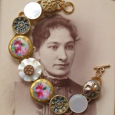 antique button bracelet. How pretty! Earrings from these types of buttons would be pretty too.