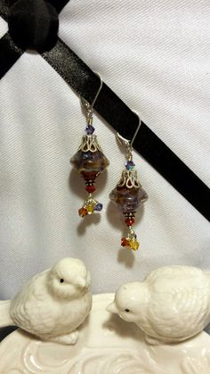 Check out this item in my Etsy shop https://www.etsy.com/listing/208729754/plum-smoke-lampwork-dangle-earrings