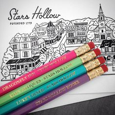 Set of four wooden #2 pencils imprinted with names of the charming businesses of Stars Hollow from The Gilmore Girls:  Dragonfly Inn Lukes Diner Stars Hollow Books Kims Antiques  You can buy these 4 pencils on their own ($8) or as a set with 4 greeting cards/envelopes ($14.50). ***Note: Im out of cards right now, and Ill have more soon. I have lots of pencils available.*** The 4 x 6 inch greeting cards feature my illustration of Stars Hollow (blank interior). All pencils arrive unsharpen...