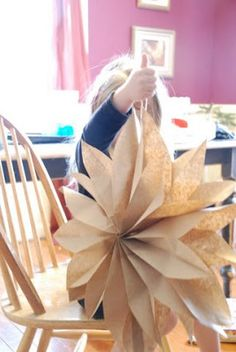 paper bag hanging flowers for a backdrop.. white, brown, and possibly navy?