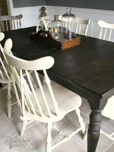 Update a Farm Table with Dark Stain. An old orangey Farm Table gets a new look after stripping and re-staining with a dark ebony-walnut stain. Painted Kitchen Tables, Kitchen Table Makeover, Farmhouse Kitchen Tables, Farmhouse Plans, Black Kitchen Tables, Farmhouse Chairs, Kitchen Black, Kitchen Redo, Rustic Farmhouse
